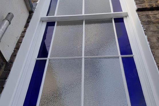 Blue Glass Sash Window After
